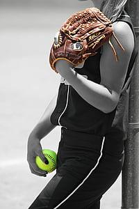 woman holding baseball mitt and ball