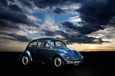 photo of blue new beetle under sky