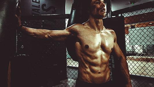 standing topless man