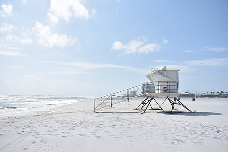 white lifeguard house in the beach