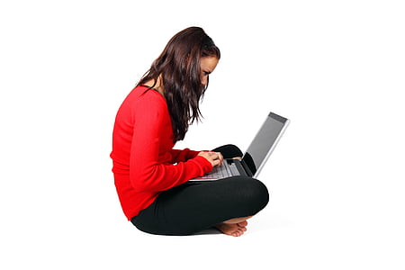 woman wearing red long-sleeved shirt holding laptop