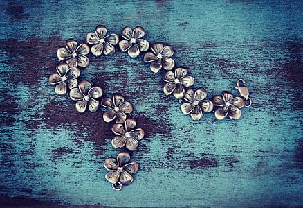 silver-colored floral chain bracelet