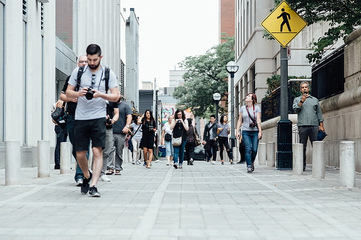 Royalty-Free photo: Low-angle photography of group of people walking on the  side of the streets | PickPik
