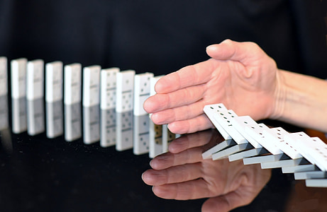 person stop fall dominoes