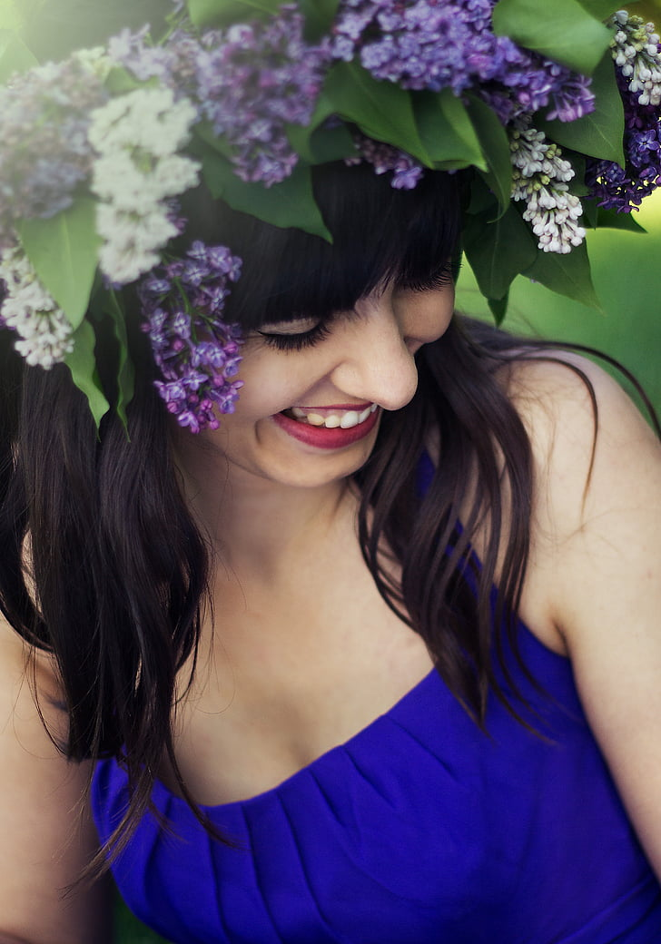 closeup photo of woman in blue sleeveless top
