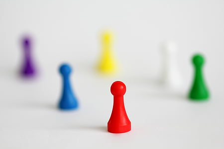 selective focus photography of red chess piece