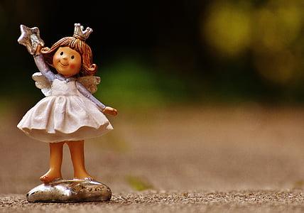 focused photo of girl ceramic figurine