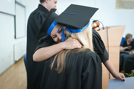 two women hugs during graduation