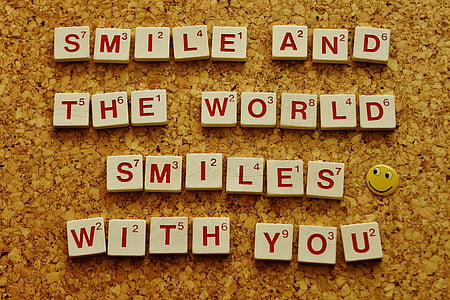 smile and the world smiles with you scrabble piece saying