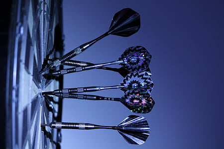 dart board pins pinned on dart board