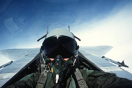 pilot riding plane during daytime