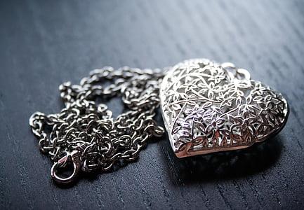 silver-color heart pendant necklace