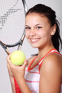 girl holding tennis racket