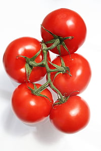 closeup photo of five red tomatoes