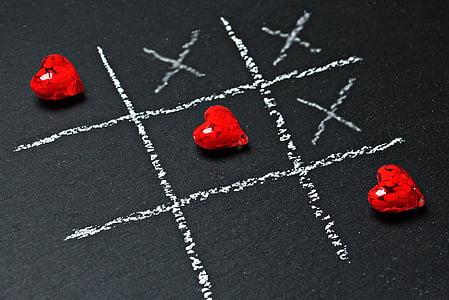 three red heart gemstones