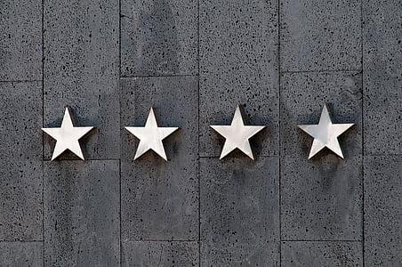 four white star wall decors