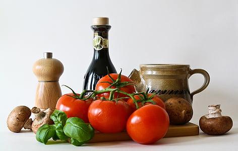 tomatoes, basil, pepper mill, mushrooms, and cruet bottle still life photo