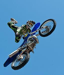 man riding blue motocross dirt bike