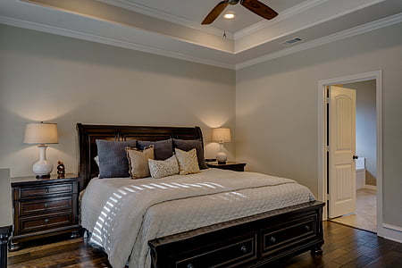white comforter and black frame