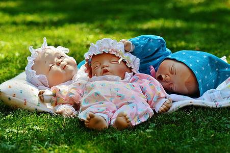 three sleeping baby d olls