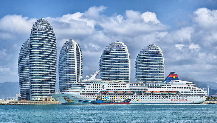 white cruise ship on body of water during daytim