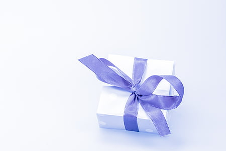 white gift box with blue bow