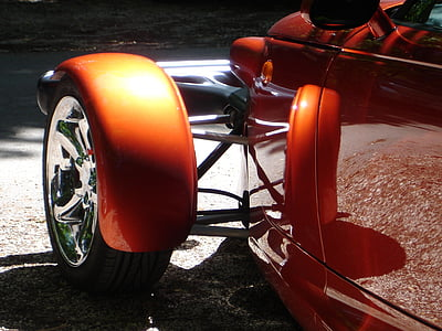 orange car with black tire