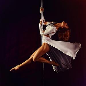woman pole dancing