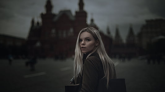 woman with cathedral behind