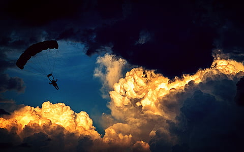 man in parachute during night time
