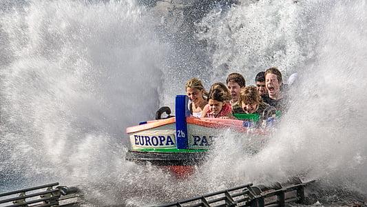 people riding theme park ride