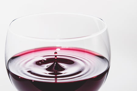 red wine in wineglass closeup photo