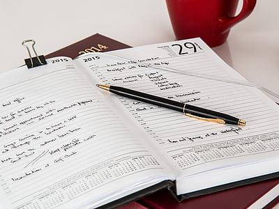 black pen on white planner