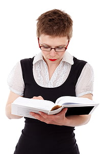 woman holding white hardbound book