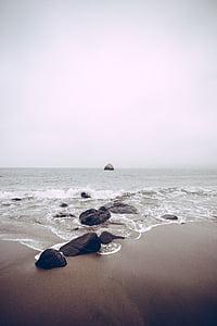 photo of rocks near beach