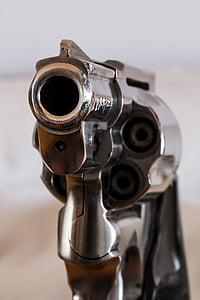 close up photo of gray revolver