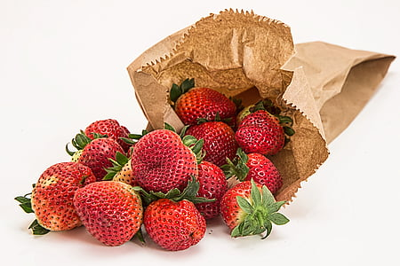 strawberries and brown paper bag