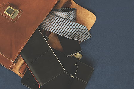 gray and black striped necktie beside black wallet