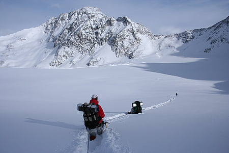 man walking on snowy ground