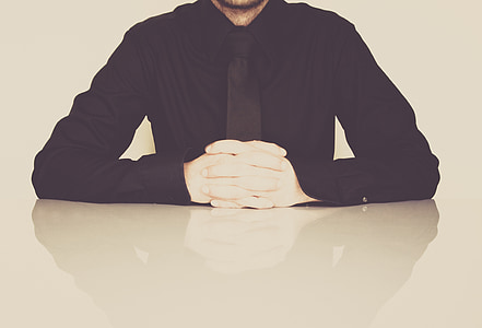 man in black dress shirt and white gloves