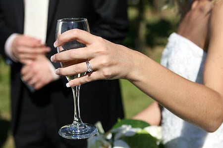selective focus photography of woman holding clear wine glass