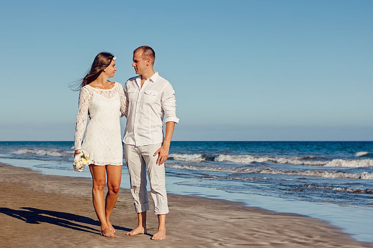 Woman In Lace Long Sleeved Mini Dress With Man White Shirt Standing On