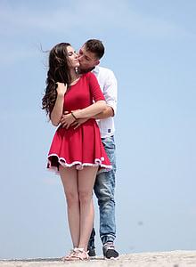 man hugging woman at the back
