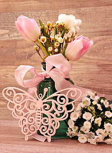 pink tulips with lace decor on tabl