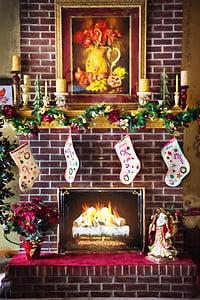 Christmas stockings hang on fireplace
