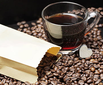 glass of coffee on coffee beans