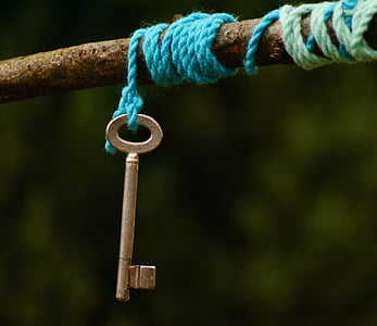 gray key and blue rope
