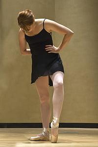 ballerina wearing black dress