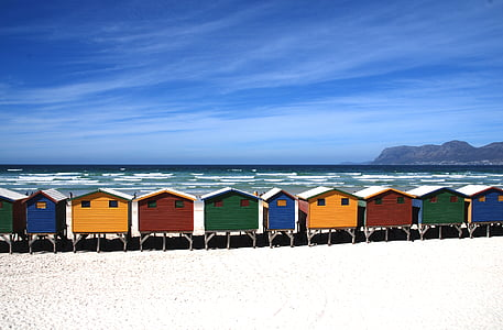 assorted-color of houses on seashore near island during daytime