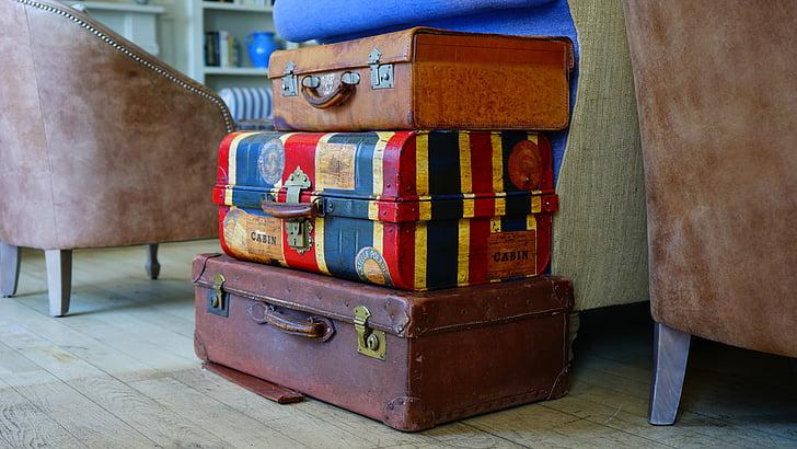 Royalty-Free photo: Three assorted-color luggage bags near sofa | PickPik